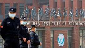 Security personnel keep watch outside the Wuhan Institute of Virology in Wuhan, Hubei province, Chin