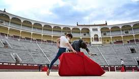 "Bullfighting School pupil Alvaro Burdiel, 22, practises at Las Ventas bullring in Madrid. The ""toro,"
