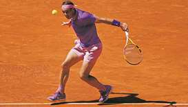Nadal makes last eight as Barty eases into final