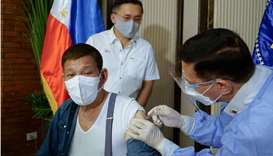 Philippine President Rodrigo Duterte (L) receiving a dose of vaccine against the Covid-19 coronaviru