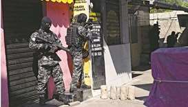 Officers are seen during an operation against drug traffickers at the Jacarezinho favela in Rio de J