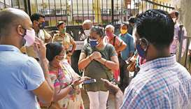 People stand outside a Mumbai vaccination centre yesterday which was closed due to the shortage of C