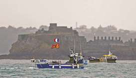 French fishing boats are seen near the port of Saint Helier, off the British island of Jersey, to dr