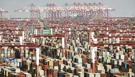 Shipping containers next to gantry cranes at the Yangshan Deepwater Port in Shanghai. China's export