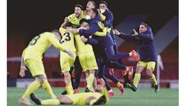 Villarreal players celebrate after the Europa League semi-final second leg against Arsenal in London