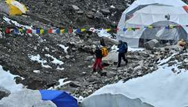 Expedition members wearing facemask arrive at Everest base camp, some 140 Km northeast of Kathmandu.