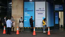 People wait in line at a coronavirus disease (Covid-19) testing clinic in the city centre after new