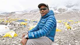 Nepal's mountaineer Kami Rita Sherpa poses for a picture during an interview with AFP at the Everest