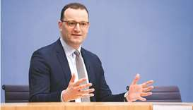 German Health Minister Jens Spahn gestures during a news conference on the current coronavirus disea
