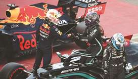 Mercedes' British driver Lewis Hamilton (C) is congratulated by Red Bull's Dutch driver Max Verstapp