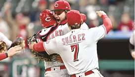 Cincinnati Reds starting pitcher Wade Miley (centre) and catcher Tucker Barnhart and third baseman E