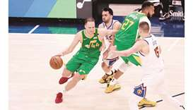 Utah Jazz forward Bojan Bogdanovic (left) plays through a screen set by center Rudy Gobert (second f