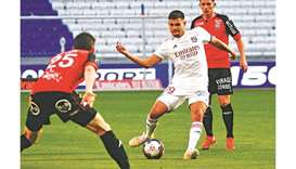 Lyon's Bruno Guimaraes (centre) in action during the Ligue 1 match against Lorient in Décine-Charpie