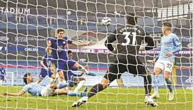 Chelsea's Marcos Alonso (centre) shoots to score the winner during the EPL match against Manchester