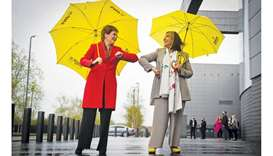 Scotland's First Minister and leader of the Scottish National Party (SNP) Nicola Sturgeon (left) con