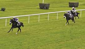 Guillaume Guedj–Gay (left) guides Moharram to Prix Djelfor victory in Bordeaux, France, on Sunday. (
