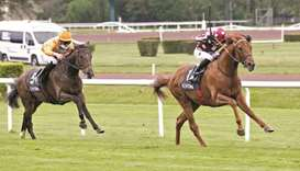 Julien Guillochon (right) guides Mutabahi to victory in the Prix Louis Saulnier in Lyon-Parilly, Fra