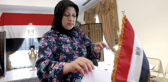 An Egyptian woman living in Bahrain casts her vote at the Egyptian embassy in Manama yesterday.