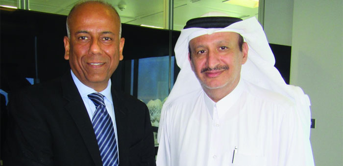 Chowdhary with al-Derbesti after concluding the 5-year contract in Doha for advanced mobile broadban