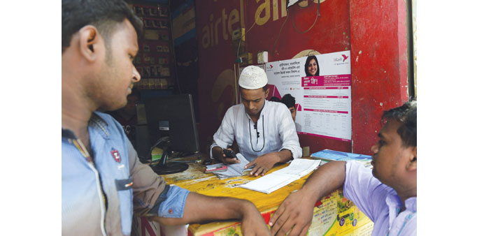 Millions benefit from mobile cash transfer in Bangladesh
