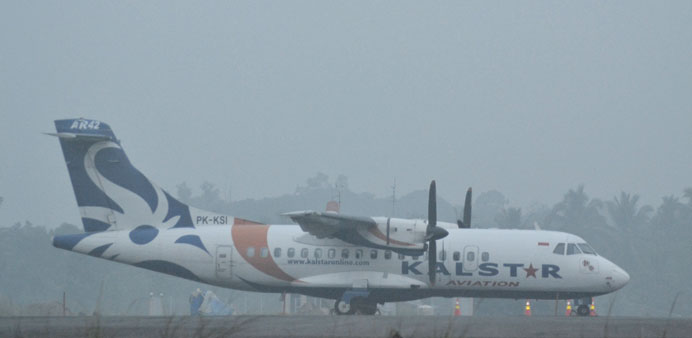 A Kalstar aircraft is seen on the tarmac of Nunukan Airport as they cancel their trip because of haz