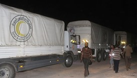 A United Nations and Syrian Arab Red Crescent aid convoy enters the Syrian rebel-held town of Daraya