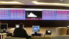 Qatar shares drop to settle 8,300 points despite buying support