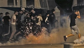Police disperse revellers at the old port of Marseille after the England vs Russia - Group B match