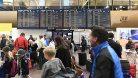 Passengers wait for flight information at Arlanda Airport