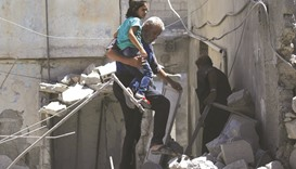 Air raids on market in Idlib city kill 21