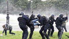 26 hurt in Paris clashes between police, masked protesters