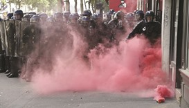 Masked protesters clash with Paris police, 26 hurt