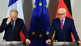 German Foreign minister Frank-Walter Steinmeier (R) and his French counterpart Jean-Marc Ayrault