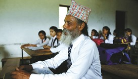 Nepalese grandfather of eight goes back to school