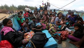Sri Lankan immigrants on their boat after being stranded at Pulo Kapuk beach in Lhoknga