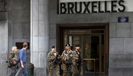 Belgian soldiers patrol outside the central train station in Brussels