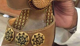 shoes imprinted with the word Om