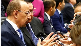 Saudi Arabia's Energy Minister Khalid al-Falih (L) talks to journalists before a meeting of OPEC oil