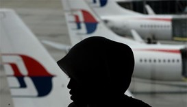 Rough seas, high winds delay search for Flight MH370