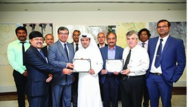 Khaled Saif al-Khayarein with representatives of the project contractor, a Larsen and Toubro and Gal