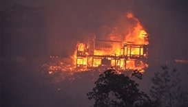 A house burning in the Erskine Fire near Lake Isabella, California