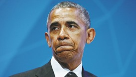 Obama tries to limit fallout
