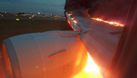 Fire engulfs plane's wing after emergency landing in Singapore