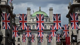 Union flags fly as banners across a street in central London