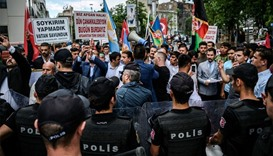 Turkish anti-riot police officers block the street on June 4, 2016 as protesters shout slogans again