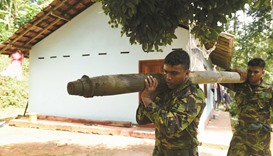 Lanka races to defuse bombs after depot blast