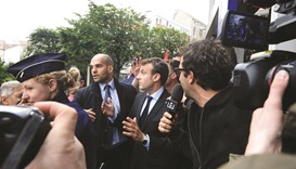 French minister pelted with eggs as strikes wane