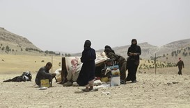 Residents flee as fighters near IS-held Syria town