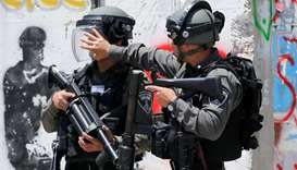 Israeli soldiers stand guard