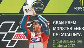 Dovizioso stays cool to win searing Catalan GP